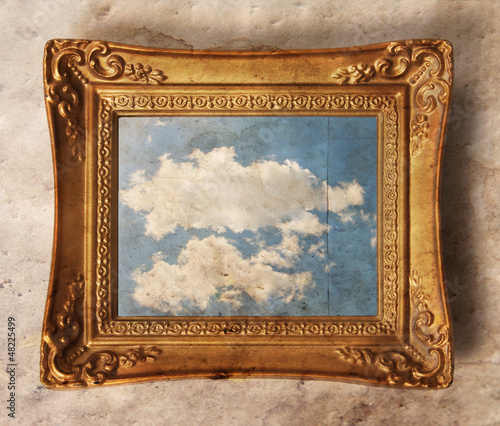 a vintage photo frame with a cloud in it