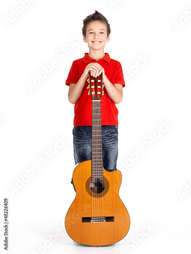 caucasian boy with acoustic guitar isolated on white