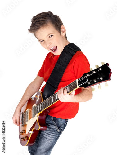 Portrait of young boy with  electric guitar