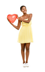 Pretty African American woman holding Red Heart Balloon isolated