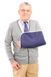 A senior man with broken arm posing
