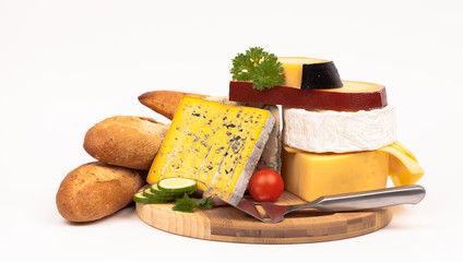 Various types of cheese and vegetables isolated on white