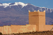 Wall with tower over film studios in Moroccan atlas mountains