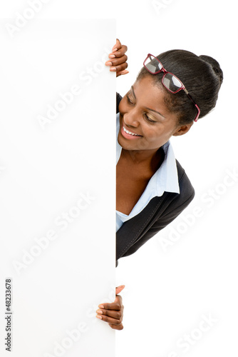 Happy African American business woman hiding behind banner isola