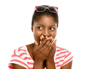 Cute African American woman hand covering mouth isolated on whit