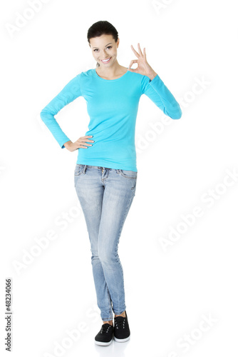 Beautiful success woman giving perfect gesture