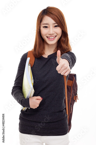 Young happy Asian student show thumb.