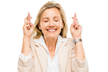 Mature businesswoman holding fingers crossed isolated on white b
