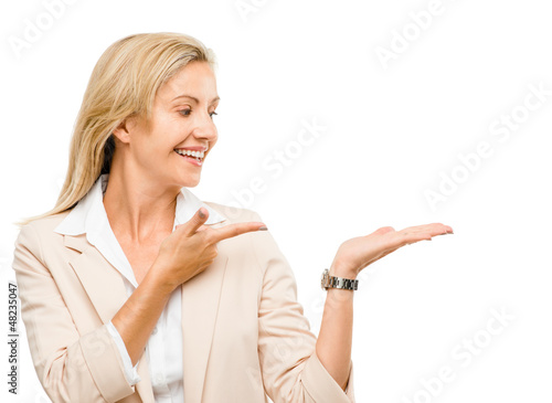 Mature woman showing empty copy space isoated on white backgroun