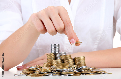 Woman hands with coins, close up