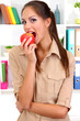 Young businesswoman eating an apple