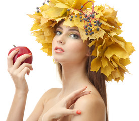 beautiful young woman with yellow autumn wreath and apple,