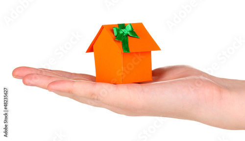 Small house in hand isolated on white