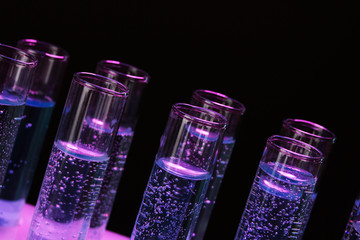 test-tubes with liquid on black background