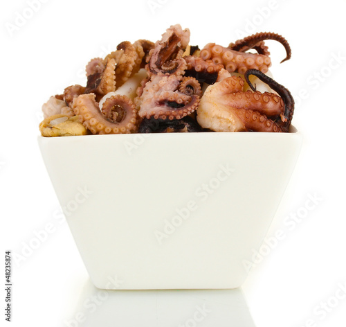 Tentacles of octopus in bowl isolated on white