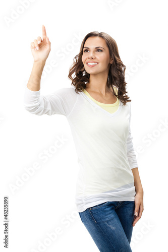 Beautiful young woman showing blank signboard