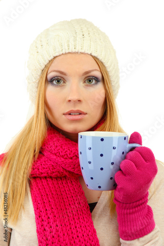 Attractive young woman holding cup with hot drink, isolated