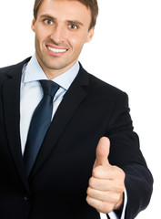 Young businessman with thumbs up gesture, isolated