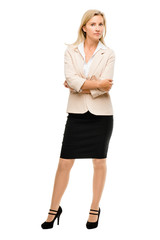 Unhappy business woman standing arms folded