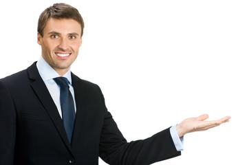Businessman showing area for sign or copyspase
