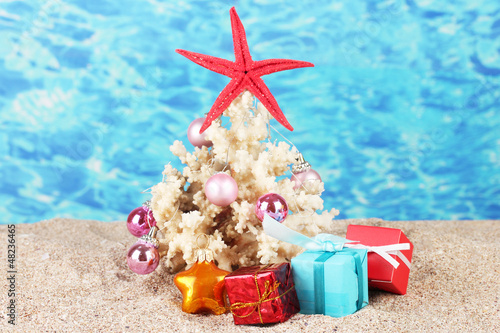 Conceptual photo: Celebrating Christmas at beach
