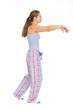 Full length portrait of young woman in pajamas sleep walking