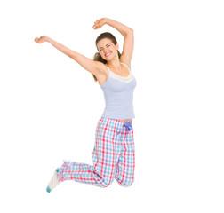 Happy girl in pajamas jumping