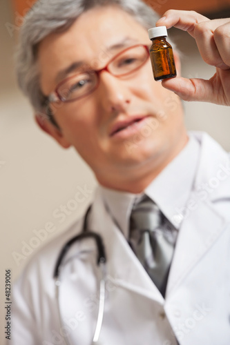 Physician Holding Medicine Bottle