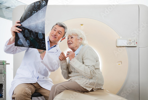 Doctor And Patient Looking At CT Scan X-ray