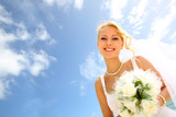 Portrait of beautiful bride with blue sky in background