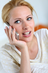 Portrait of blond girl using smartphone