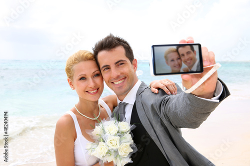 Bride and groom taking picture of themselves