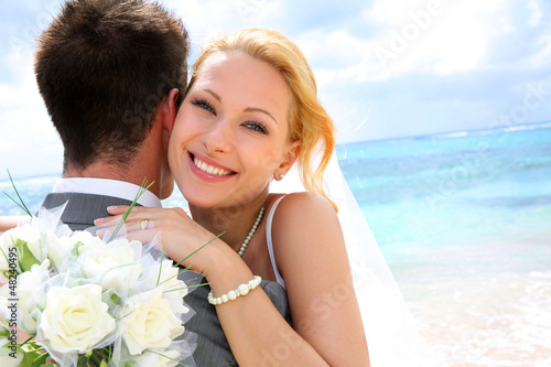 Bride embracing her groom