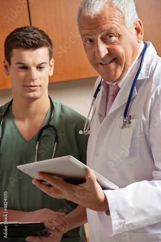 Senior Doctor Holding Clipboard