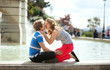 Kissing by the fountain in Paris