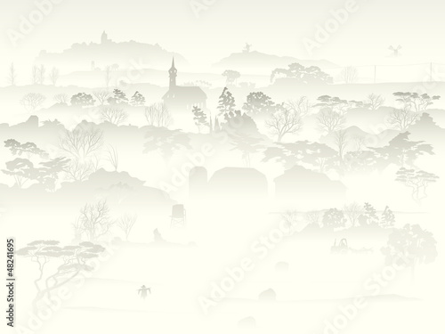 Valley with trees and farm in a morning fog.