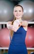 Sportswoman in sportswear stretching herself in gym class