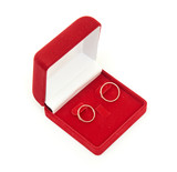 Wedding rings on red box  isolated on white background
