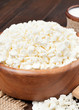 cottage cheese in rustic wooden bowl