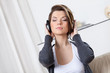 Sitting on the sofa pretty woman in headphones listens to music