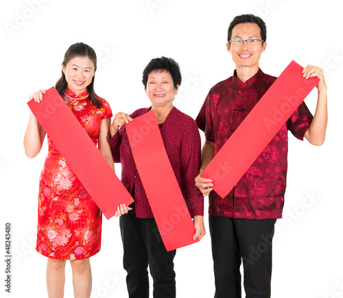 Asian Chinese family holding red spring couplets
