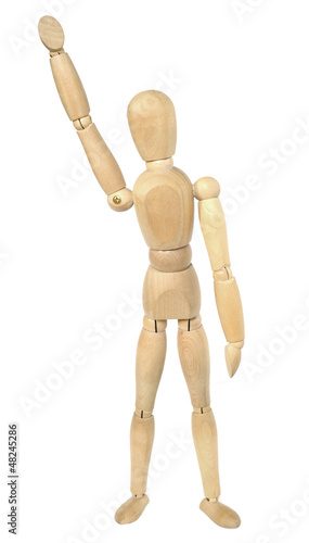 Wooden dummy with a hand up in the air