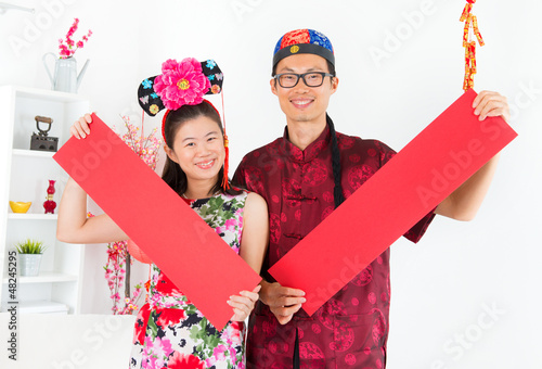 Asian people Showing red spring couplets