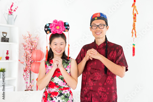 Asian people blessing during Chinese New Day