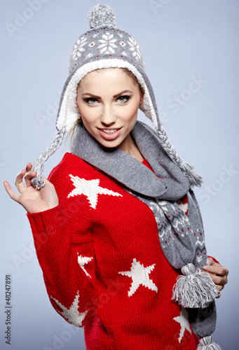 Funny woman wearing a winter cap, isolated studio portrait.
