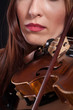 beautiful woman playing violin .