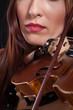 beautiful woman playing violin .
