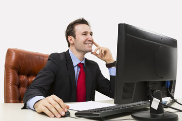 Handsome businessman smiling positively at office