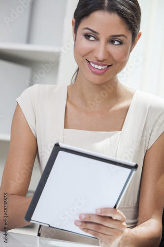 Hispanic Woman Businesswoman Using Tablet Computer