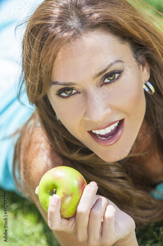 Smiling Woman Eating Apple With Perfect Teeth
